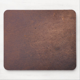 Faux leather, brown with some marks and scratches mouse mat