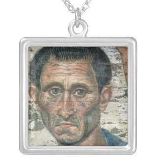 Fayum portrait of a man in a blue cloak, square pendant necklace