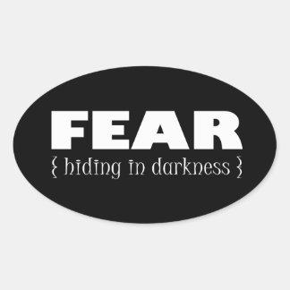 Fear - hiding in darkness oval sticker
