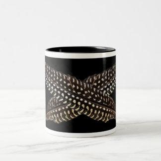 Feathers are symbols of spiritual ascension Two-Tone coffee mug