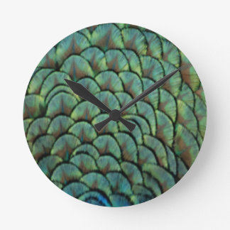 feathers of a peacock round clock