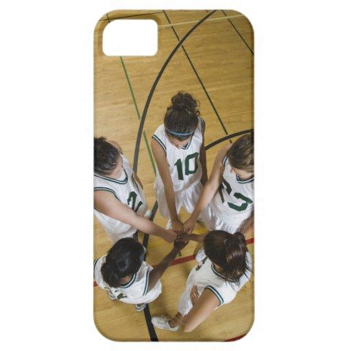 Female basketball team having group handshake, iPhone 5 cover
