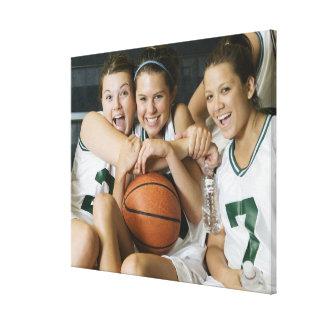 Female basketball team smiling, portrait canvas print