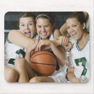Female basketball team smiling, portrait mouse mat
