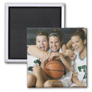 Female basketball team smiling, portrait square magnet
