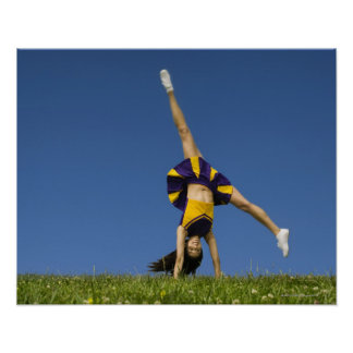 Female cheerleader doing cartwheel poster
