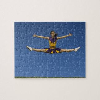 Female cheerleader doing jump splits in air 2 jigsaw puzzle