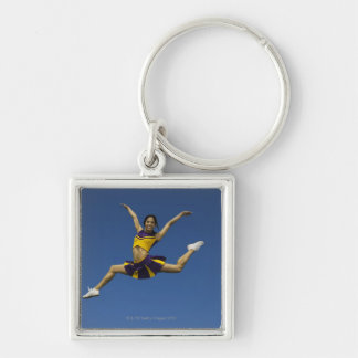 Female cheerleader jumping in air, arms Silver-Colored square key ring