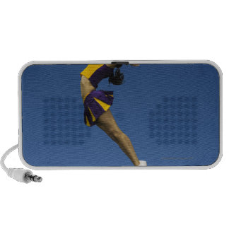 Female cheerleader jumping in air, side view mp3 speaker