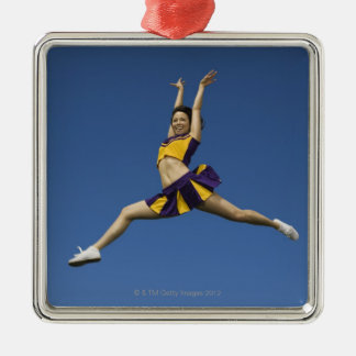 Female cheerleader jumping in air Silver-Colored square decoration