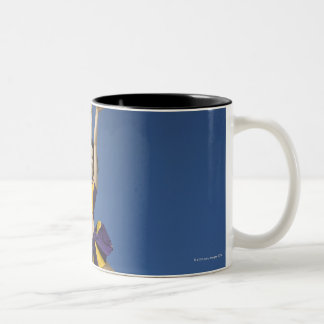 Female cheerleader jumping in air Two-Tone coffee mug