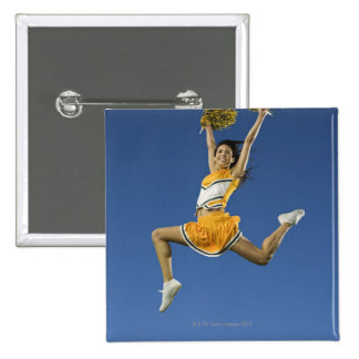 Female cheerleader jumping in air with pompoms 15 cm square badge