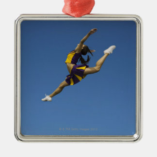 Female cheerleader leaping high up in air christmas ornament