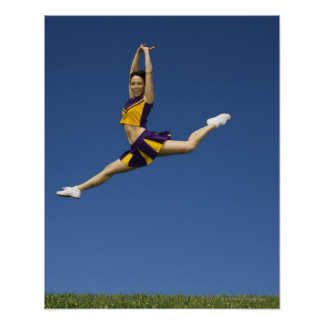 Female cheerleader leaping in air poster