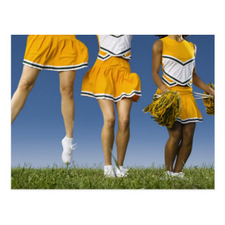 Female cheerleader s legs low section postcard