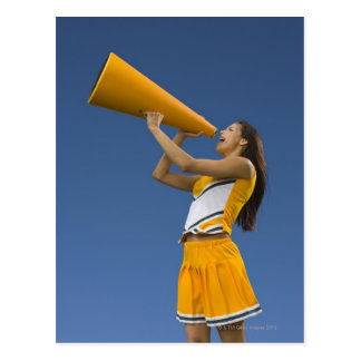 Female cheerleader shouting into megaphone postcard