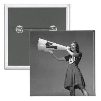 Female cheerleader using megaphone 15 cm square badge