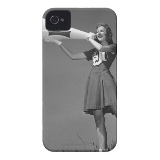 Female cheerleader using megaphone iPhone 4 cases