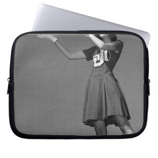 Female cheerleader using megaphone laptop sleeve