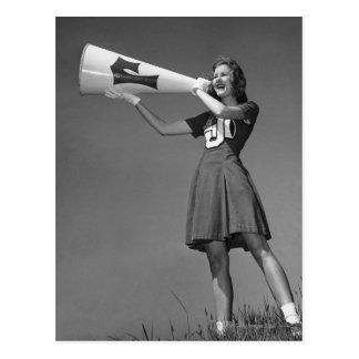 Female cheerleader using megaphone post card