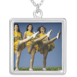 Female cheerleaders doing high kicks square pendant necklace