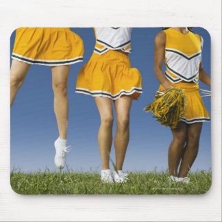 Female cheerleader's legs  (low section) mousepads