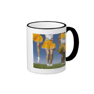 Female cheerleader's legs  (low section) coffee mug