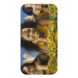 Female cheerleaders lying on grass with pompoms iPhone 4 cover