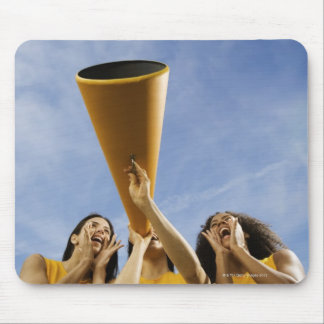 Female cheerleaders shouting through megaphone mouse pads