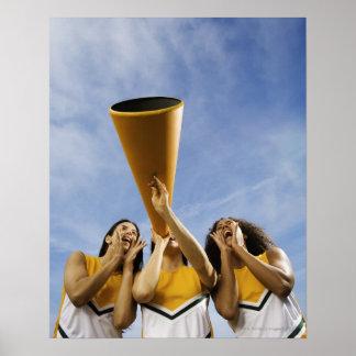 Female cheerleaders shouting through megaphone, poster