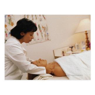 Female chiropractor massaging a patient postcard