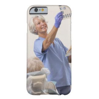 Female dental hygienist examining an X-Ray iPhone 6 Case