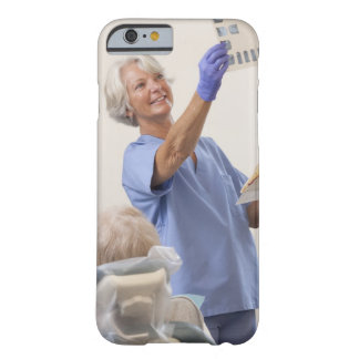 Female dental hygienist examining an X-Ray Barely There iPhone 6 Case