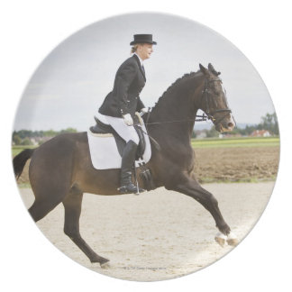 female dressage rider exercising 2 plate