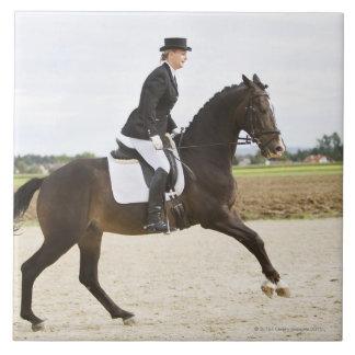 female dressage rider exercising 2 tile