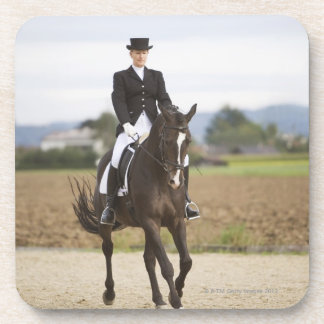 female dressage rider exercising coaster