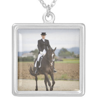 female dressage rider exercising silver plated necklace