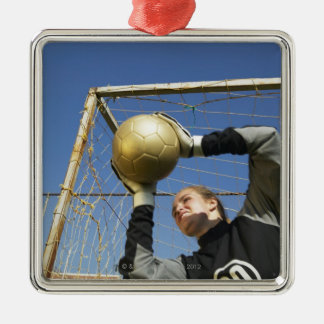 Female goalie (12-14) holding ball, low angle Silver-Colored square decoration