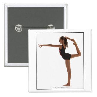 Female gymnast (12-13) balancing on one leg 15 cm square badge