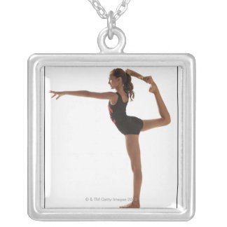 Female gymnast (12-13) balancing on one leg silver plated necklace