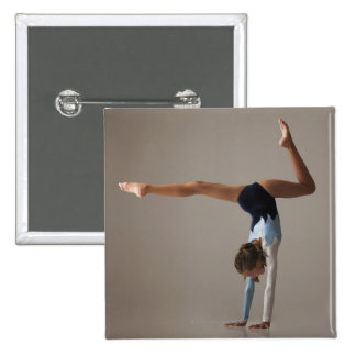 Female gymnast (12-13) performing handstand 15 cm square badge
