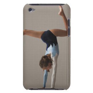 Female gymnast (12-13) performing handstand iPod touch case