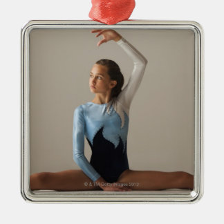 Female gymnast (12-13) performing splits christmas ornament