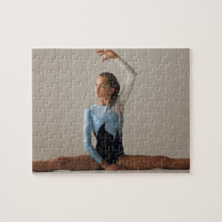 Female gymnast (12-13) performing splits jigsaw puzzle
