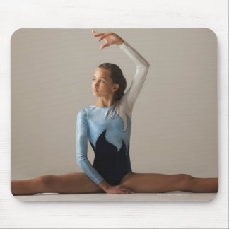 Female gymnast (12-13) performing splits mouse mat