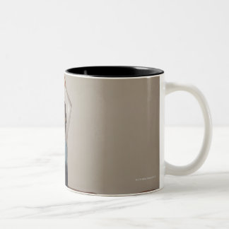 Female gymnast (12-13) performing splits Two-Tone coffee mug