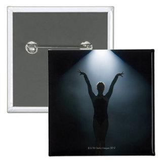 Female gymnast performing in spotlight, studio 15 cm square badge