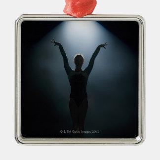 Female gymnast performing in spotlight, studio christmas ornament