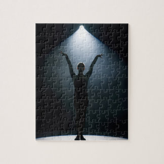Female gymnast performing in spotlight, studio jigsaw puzzle