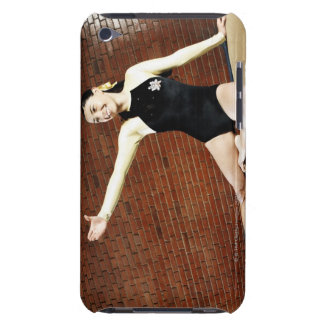 Female gymnast practicing on a balance beam and iPod touch cover